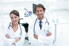 Portrait of two successful professional doctors workers in coats Royalty Free Stock Photo