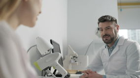 Two medical colleagues having a conversation stock footage