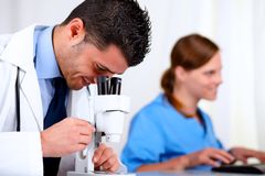 Two medical colleagues working at laboratory Royalty Free Stock Photography