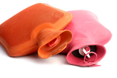 Two medical hot-water bottles. On a white background Stock Photography