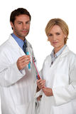 Two medical professionals stood together. Two medical professionals working together Stock Photography