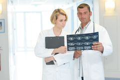Two medical technicians looking at mri x-ray patient Royalty Free Stock Image