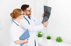 Two medical worker doctor looking an x-ray Stock Image
