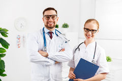 Two medical worker friendly doctor and nurse at hospital. Two medical worker friendly doctor and a nurse at the hospital stock photography