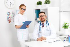 Two medical worker friendly doctor and nurse at hospital. Two medical worker friendly doctor and a nurse at the hospital royalty free stock image