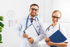 Two medical worker friendly doctor and nurse at hospital Stock Photos