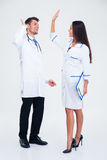 Two medical workers giving five Royalty Free Stock Photos