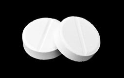 Two medicine tablets Royalty Free Stock Image