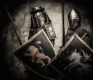 Two medieval knights. Medieval knights against stone wall Stock Images