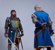 Two medieval knights standing against each other. Two medieval knights preparing to fight Stock Photography