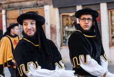 Two Medieval Men. Venice,Italy,February 26th 2011: Two young men wearing medieval costumes in a historical parade in Venice, during the Carnival days Stock Photography