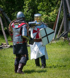 Two medieval warriors sword fight Stock Images