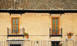 Two mediteranean windows. Two mediteranean windows on the wall, Spain Royalty Free Stock Image