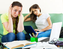 Two melancholy female students Stock Photo