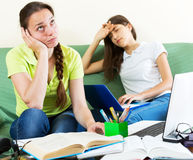 Two melancholy female students Royalty Free Stock Photos