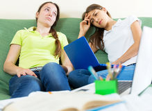 Two melancholy female students Royalty Free Stock Photography