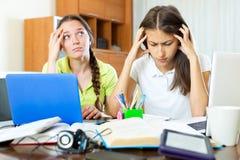 Two melancholy female students Stock Image