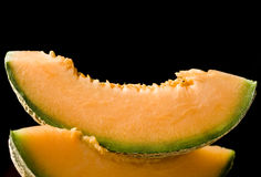 Two melon slices Stock Images