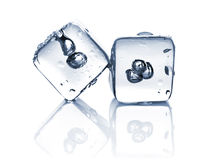 Two melting ice cubes with water dew Royalty Free Stock Photos