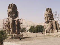 Two Memnon Colossi. Memnon Colossi, a pair of statues which are all that remains of the funerary temple of Amenhotep III. They are named after the legendary stock photo