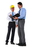 Two men architects. With helmet and plan Royalty Free Stock Images