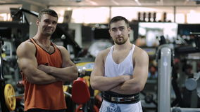 Two men athlete, professional powerlifter and stock footage