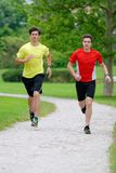 Two Men Athletes Running / Jogging Stock Images
