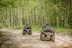Two men on the ATV Quad Bikes. Stock Photo