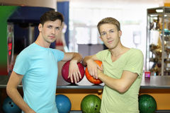 Two men with balls stand in bowling club Stock Photos