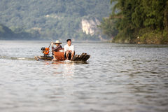 Two men on a bamboo boat on Li River near Guilin in China. Stock Image