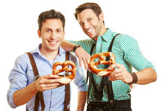 Two men in bavaria with pretzel royalty free stock photography