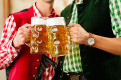 Two men in Bavarian Tracht in restaurant Royalty Free Stock Photos