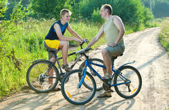 Two men on bicycles Stock Image