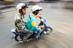 Two men on bike in Hoi An. View in motion. Stock Images