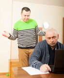 Two men  with black laptop Royalty Free Stock Photography