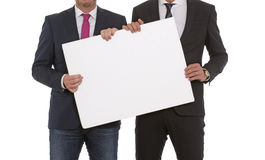 Two men with a blank sign Royalty Free Stock Photography