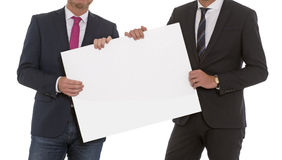 Two men with a blank sign Royalty Free Stock Photos