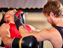 Two  men boxer wearing helmet  boxing . Two  men boxer wearing helmet and  gloves boxing .They beat each other in jaw Stock Photo