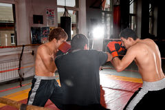 Two men is boxing on the ring Royalty Free Stock Images