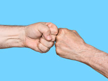 Two men bumping fists Royalty Free Stock Image