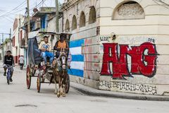 Santiago de Cuba, horse-drawn cart in front of graffiti Royalty Free Stock Images