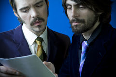 Two men checking a contract Royalty Free Stock Photos