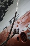 Two men in cherry picker working at ship in dry dock low angle view royalty free stock photos