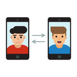 Two men communicate with mobile phones Royalty Free Stock Photos