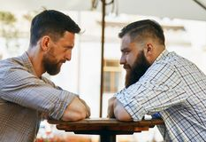 Men communicate with their views at the table. Two men communicate with their views at the table royalty free stock images