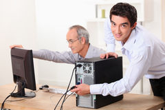 Two men with a computer Royalty Free Stock Image