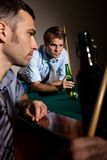 Two men concentrating on snooker Stock Image