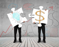 Two men connecting puzzles for idea is money concept Stock Photography