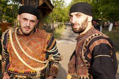 Two men in costumes of region Khevsureti, Georgia Stock Image