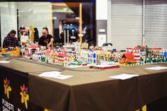 Two men are creating and constructing a lego city. In Ploiesti Mall, november 2016 Royalty Free Stock Photo